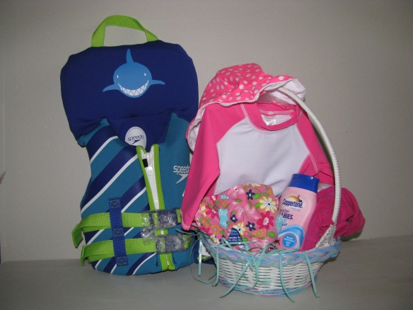 Easter basket: Life jacket, sun bonnet, swim shirt, diaper cover, coverup and baby suntan lotion! All ready for the boat!